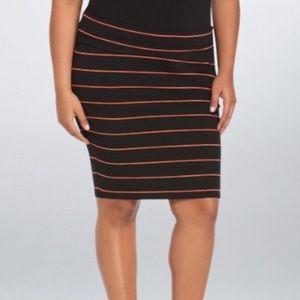 Knee length fitted skirt.